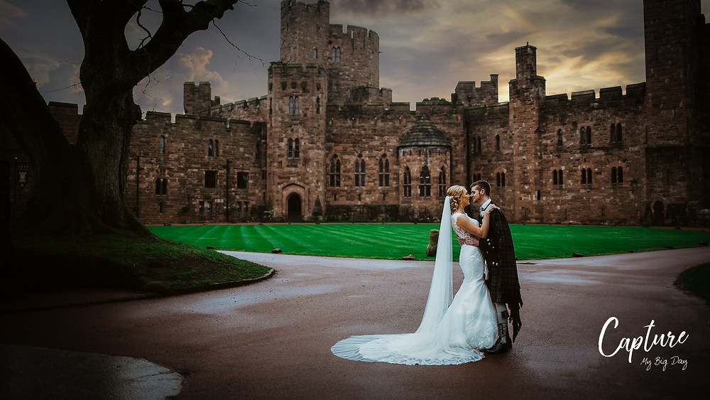 Bride and groom about to kiss outside Peckforton Castle