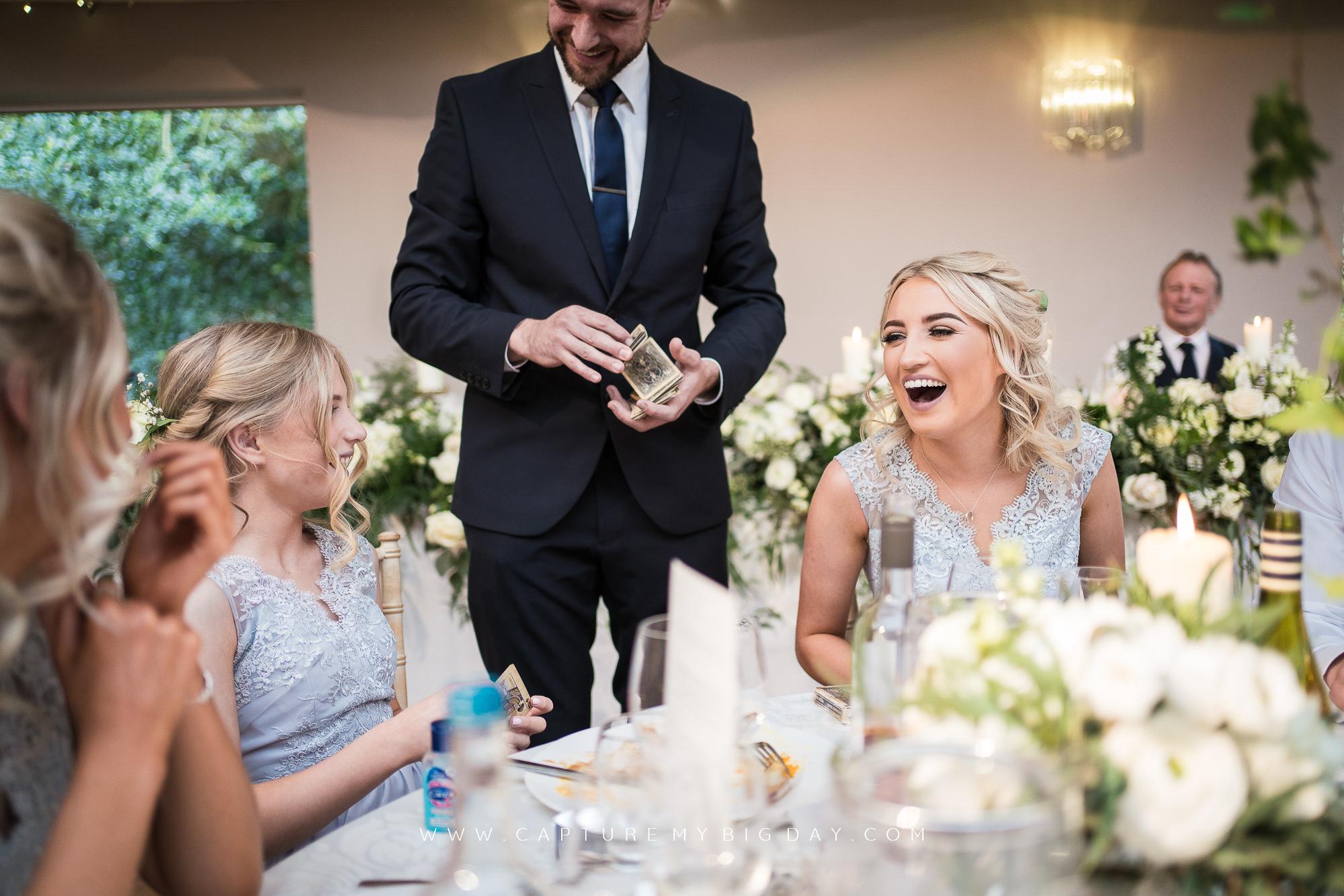 magician with bridesmaids