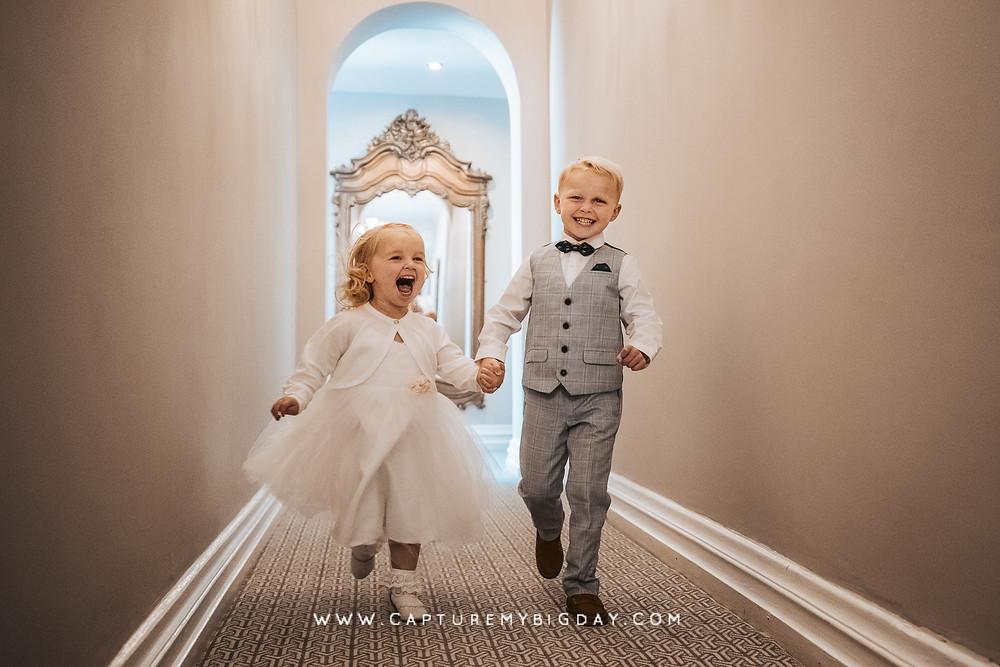 Children running through the corridors at Wrenbury Hall