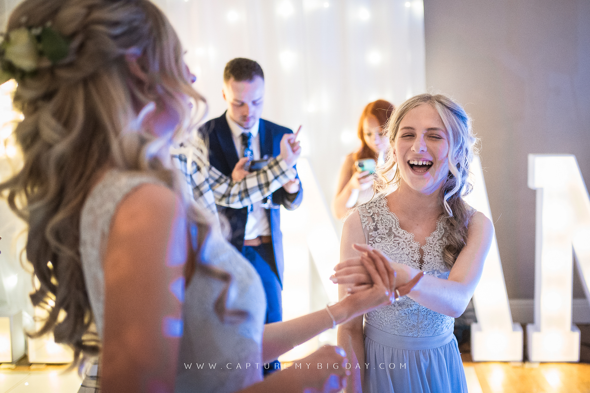 bridesmaids laughing on dance floor