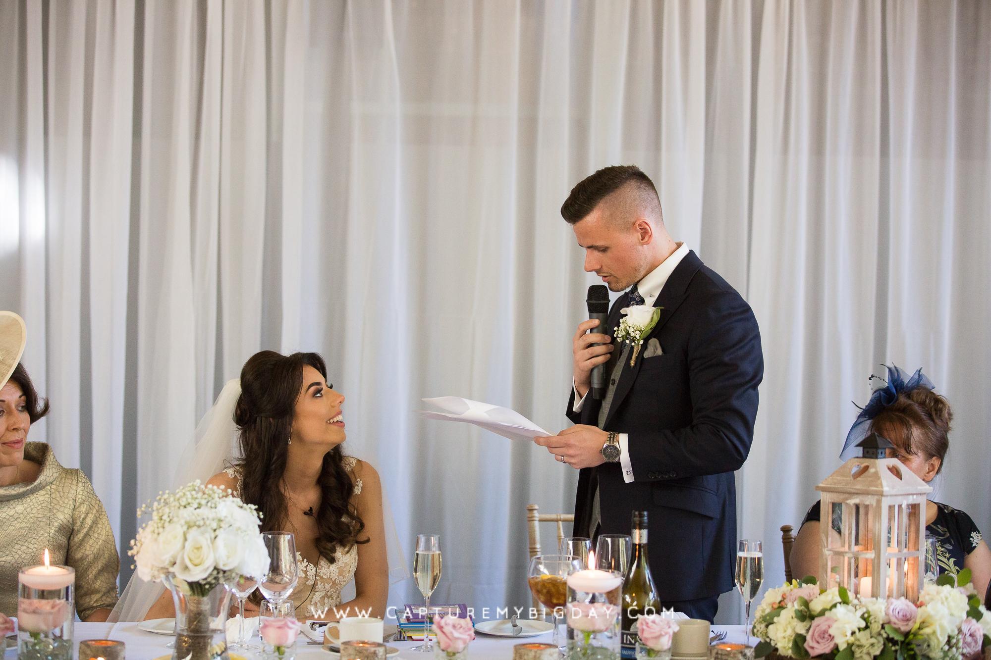 groom reading a speech