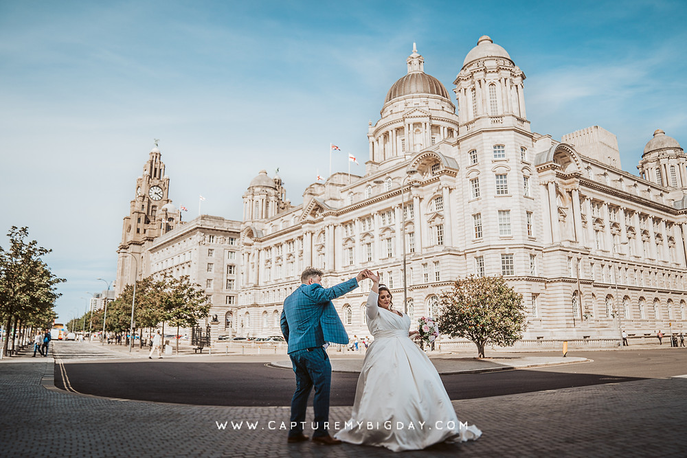 bride and groom dancing outside Liverpool building
