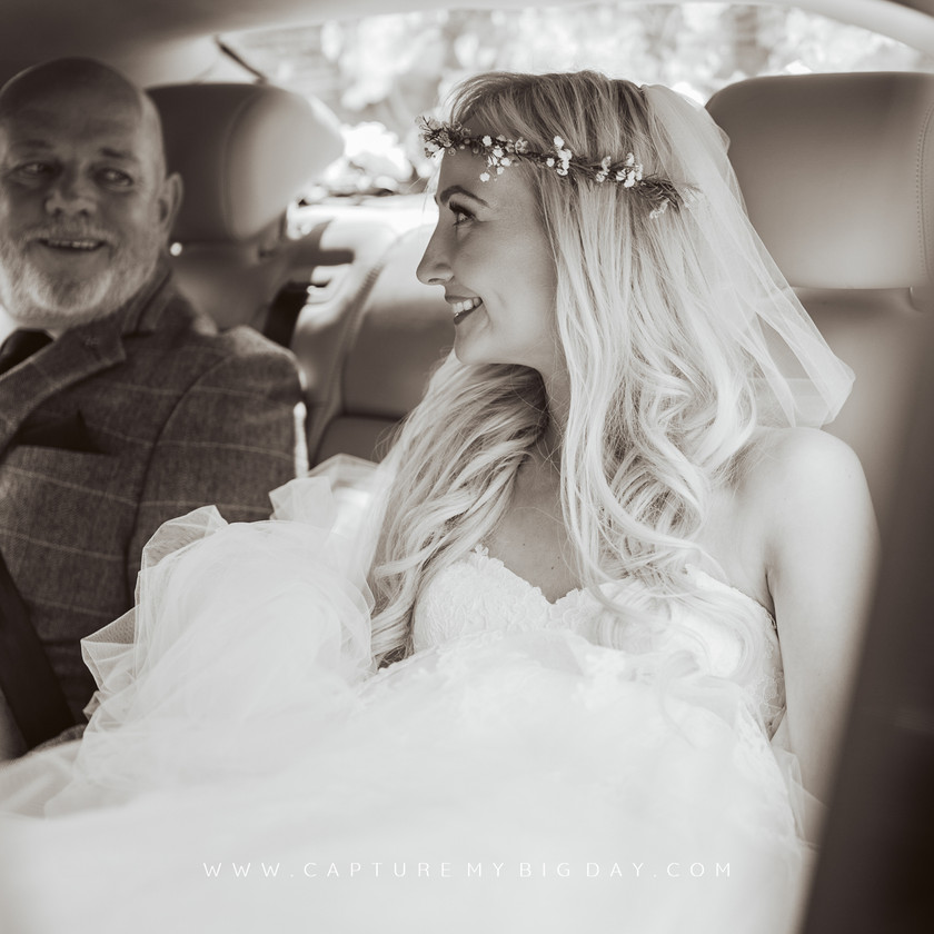 bride in car on way to church