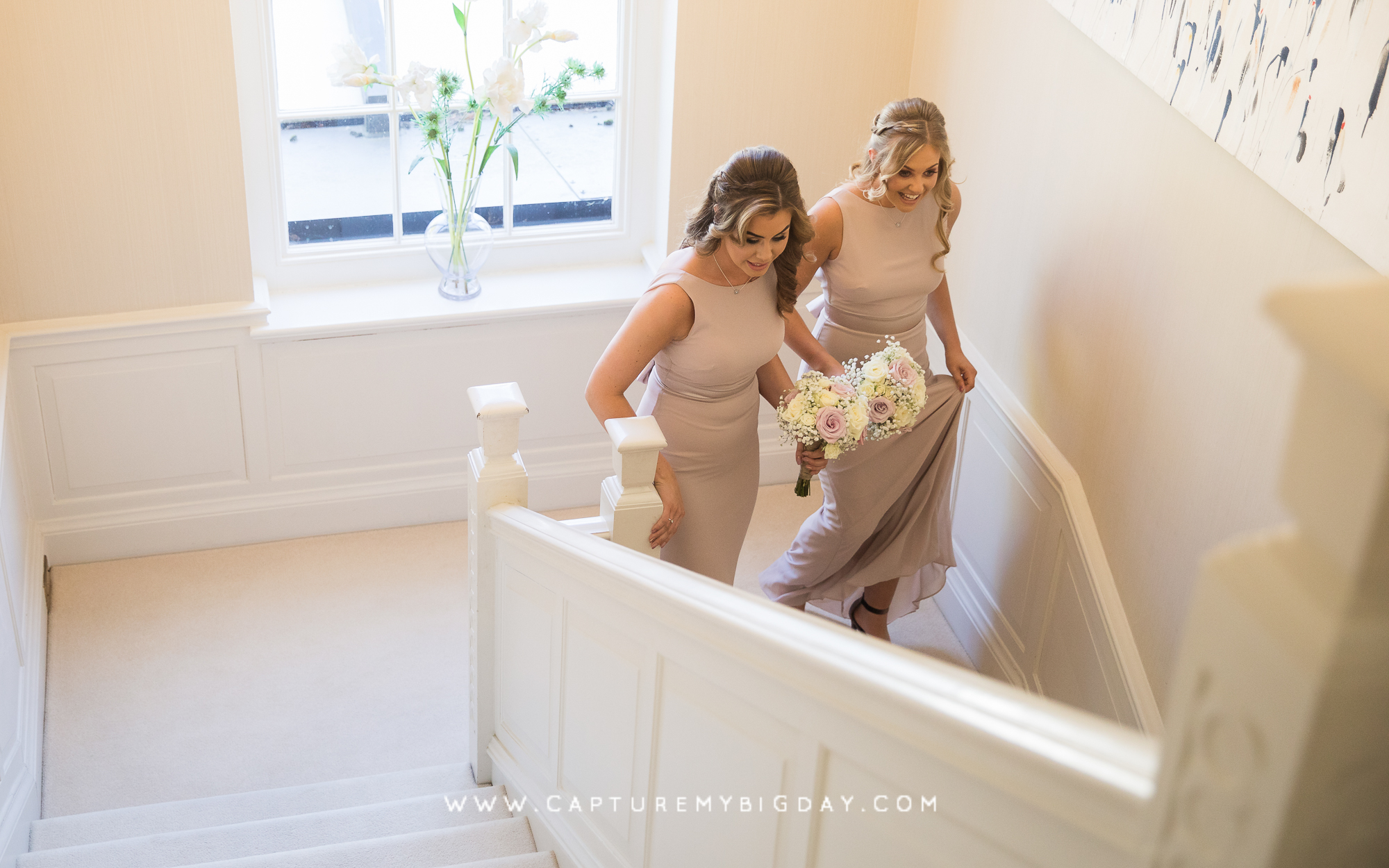 Bridesmaid going down stairs