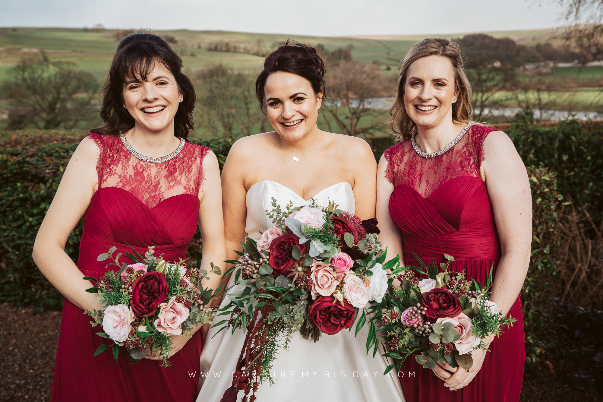 bride with bridesmaids outside