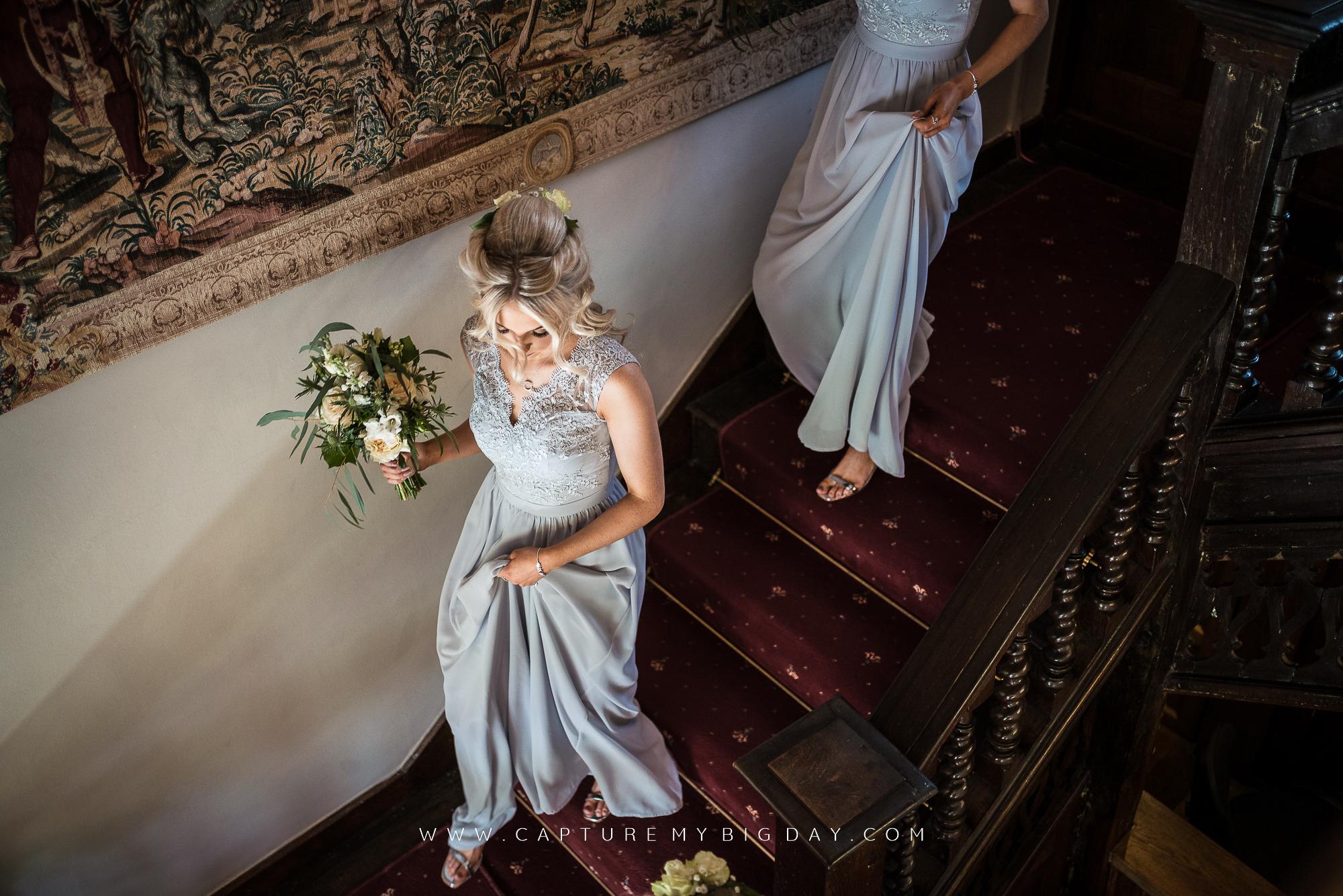 bridesmaids walking down stairs