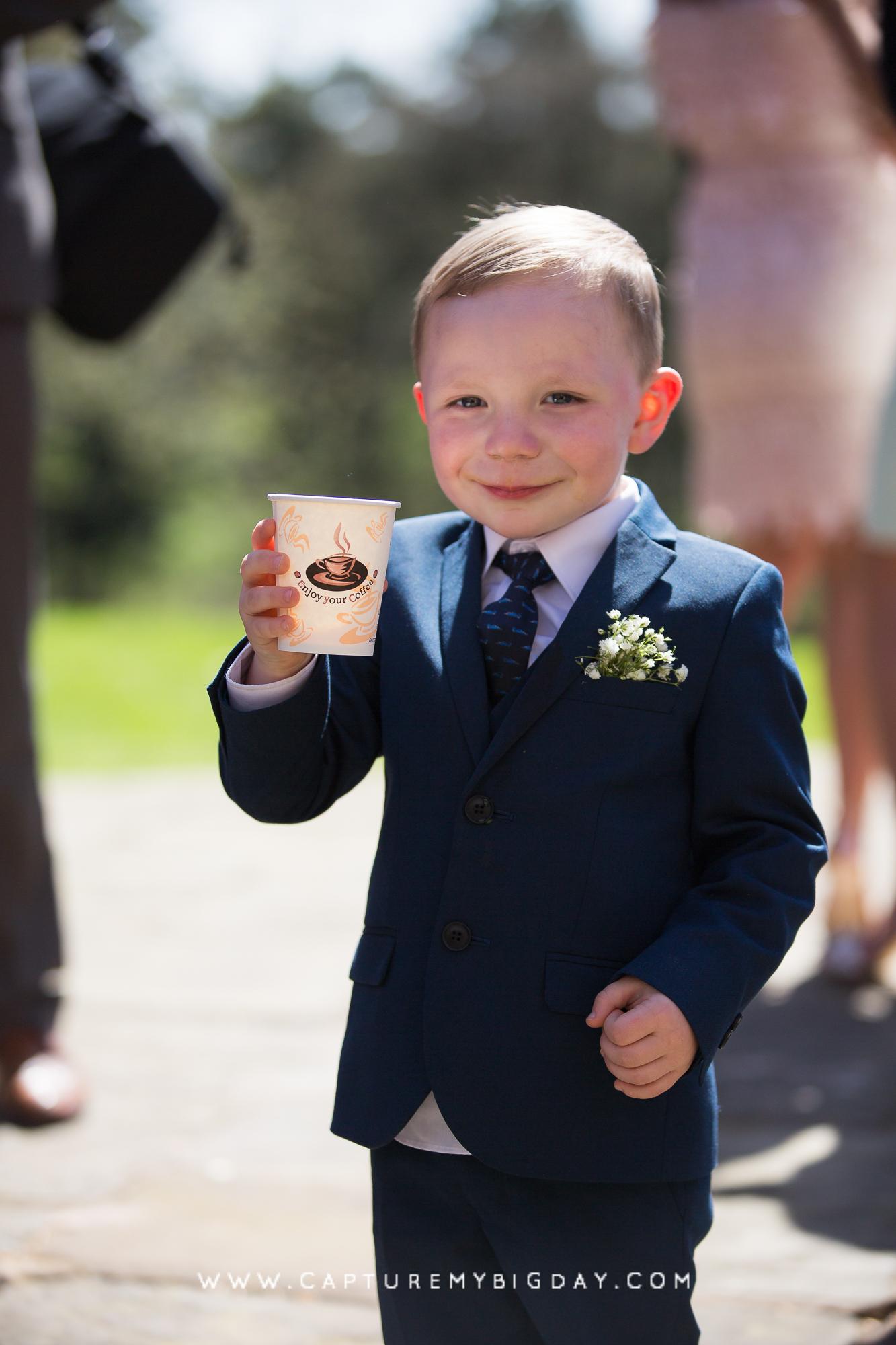 boy drinking at wedding