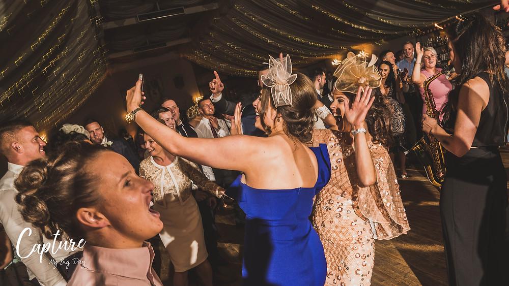 wedding guest talking selfie on dance floor