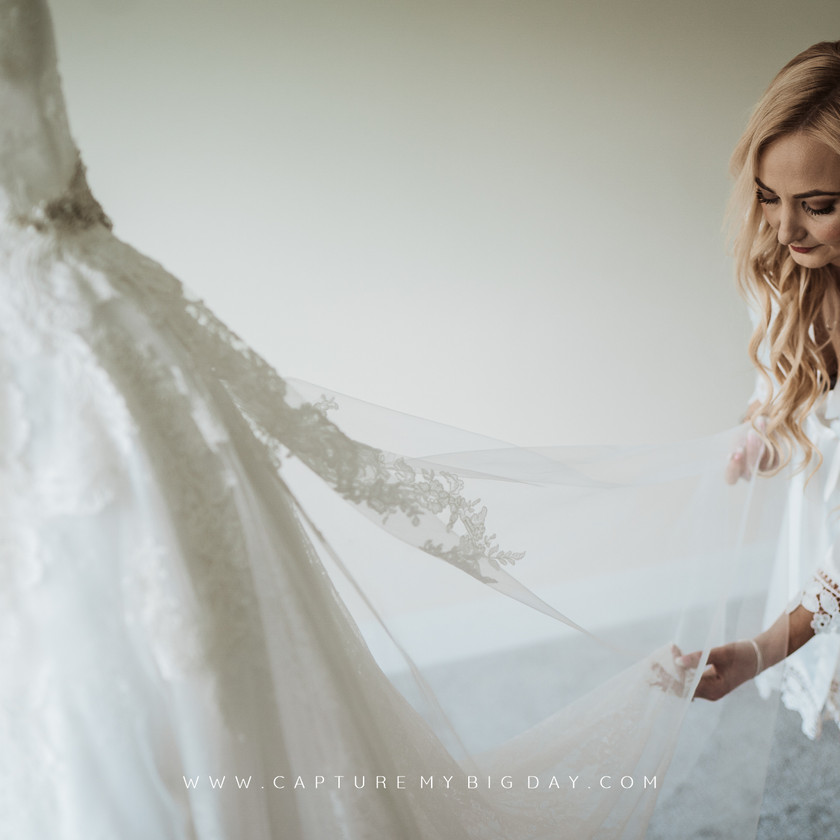 bride checking the dress