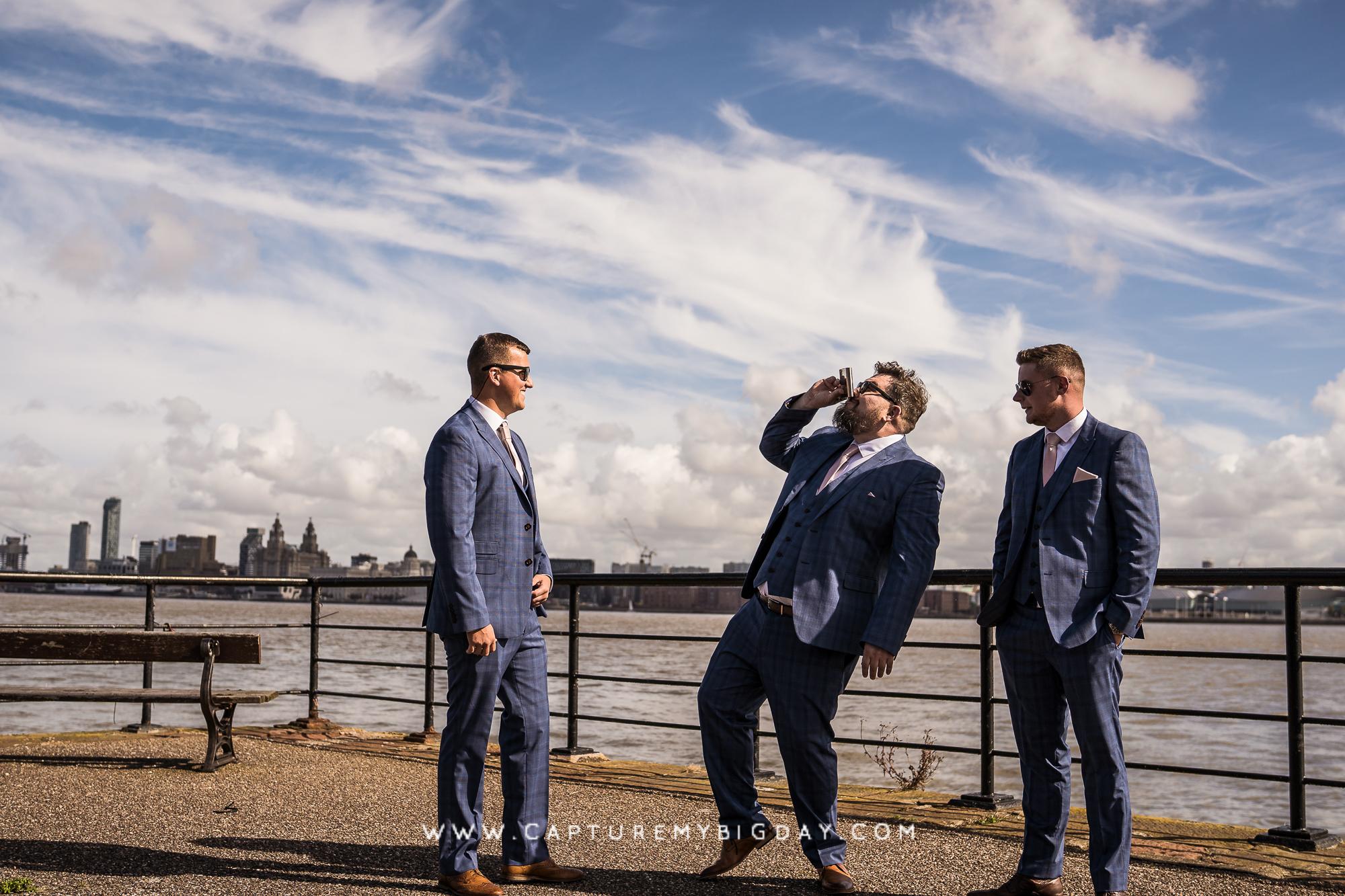 grooms men drinking at docks