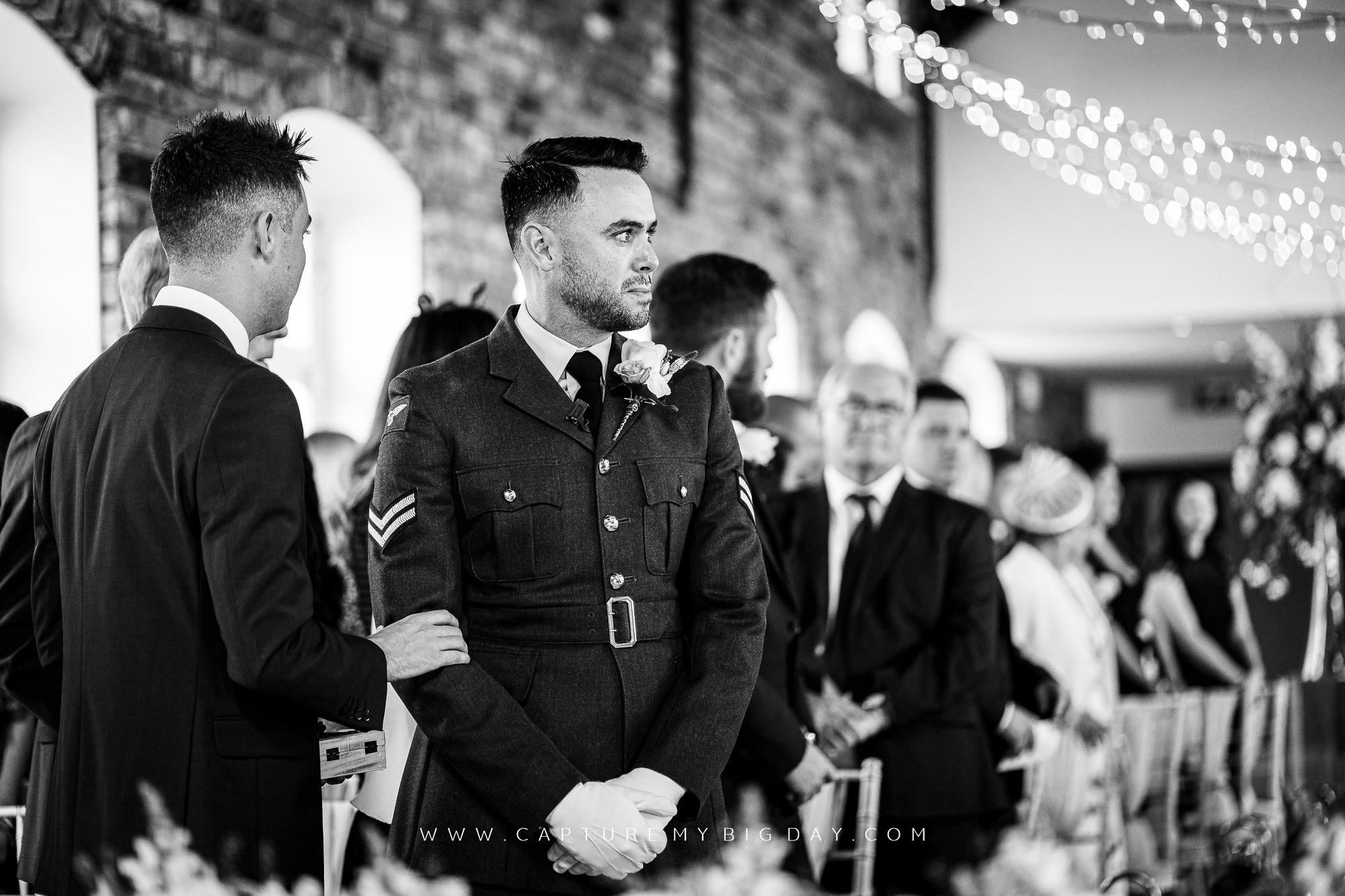 groom waiting at end of aisle
