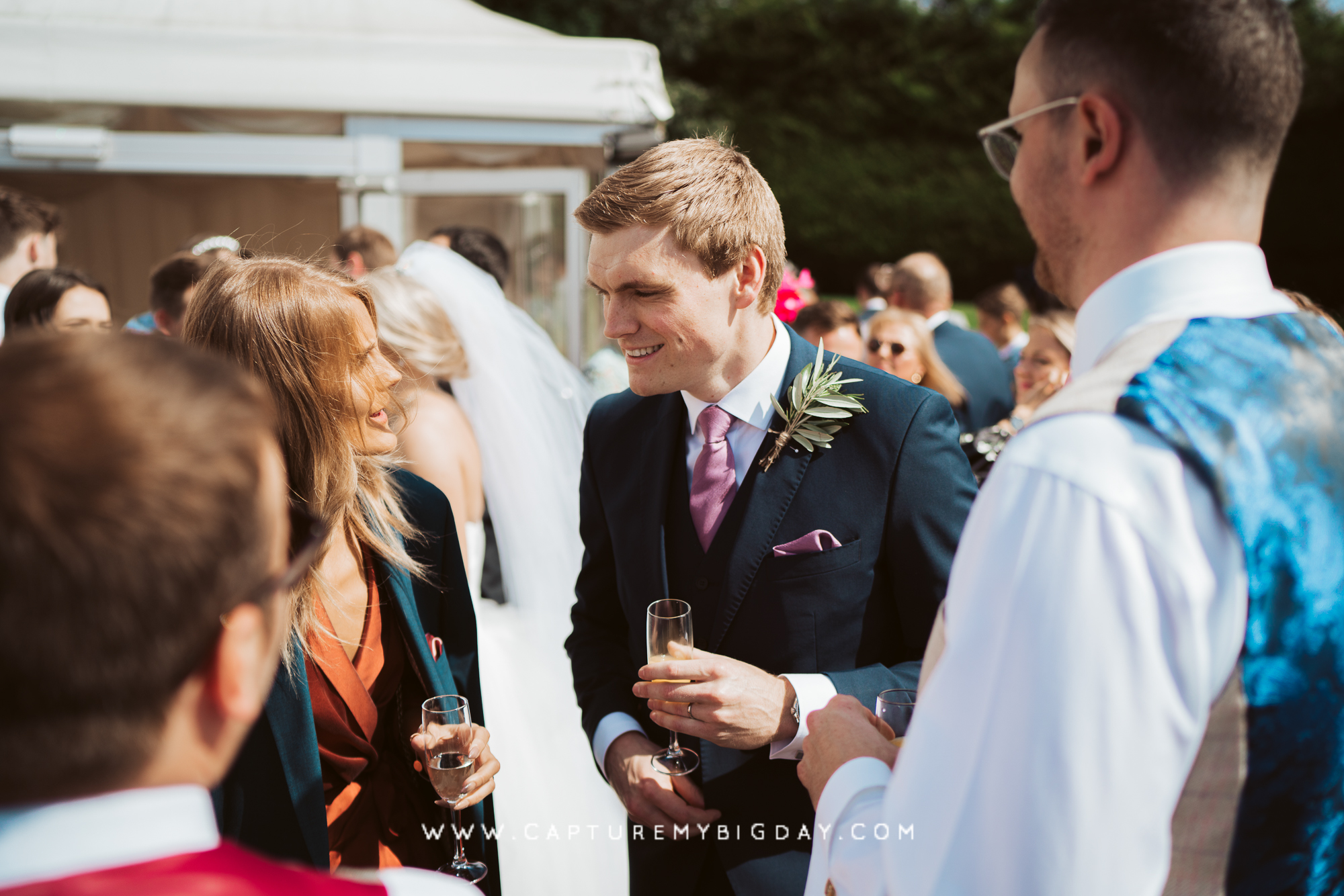 groom talking with wedding guests