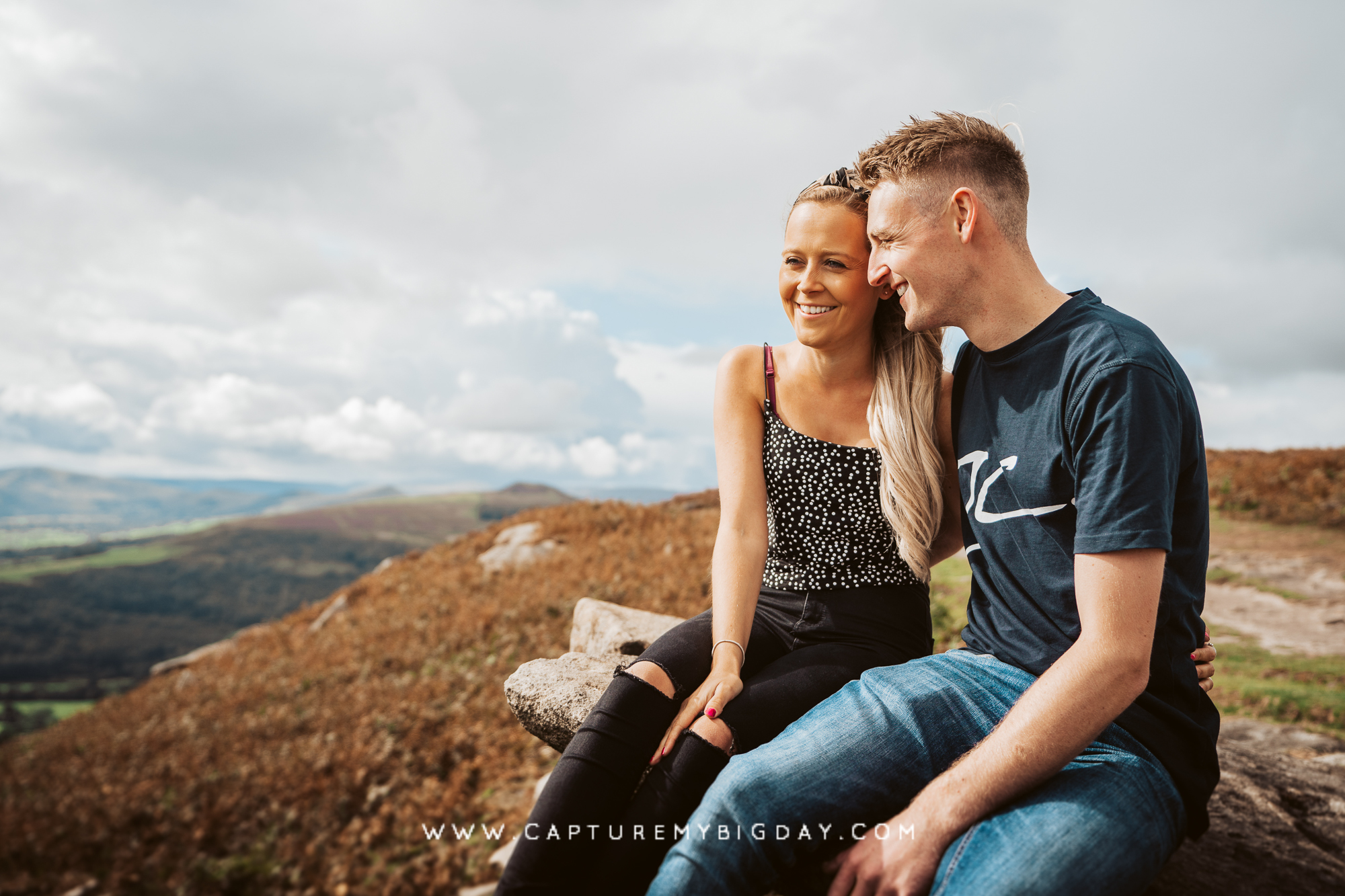 engagement photograph on a hill