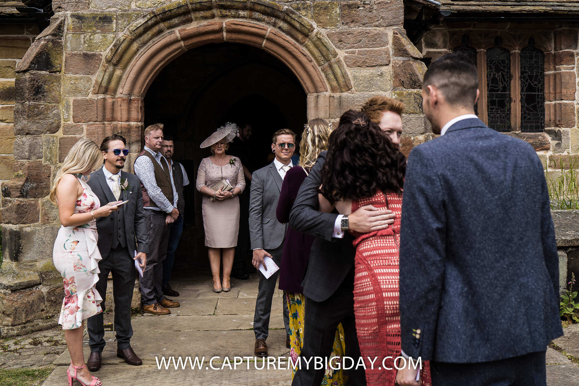 wedding guests arriving at church