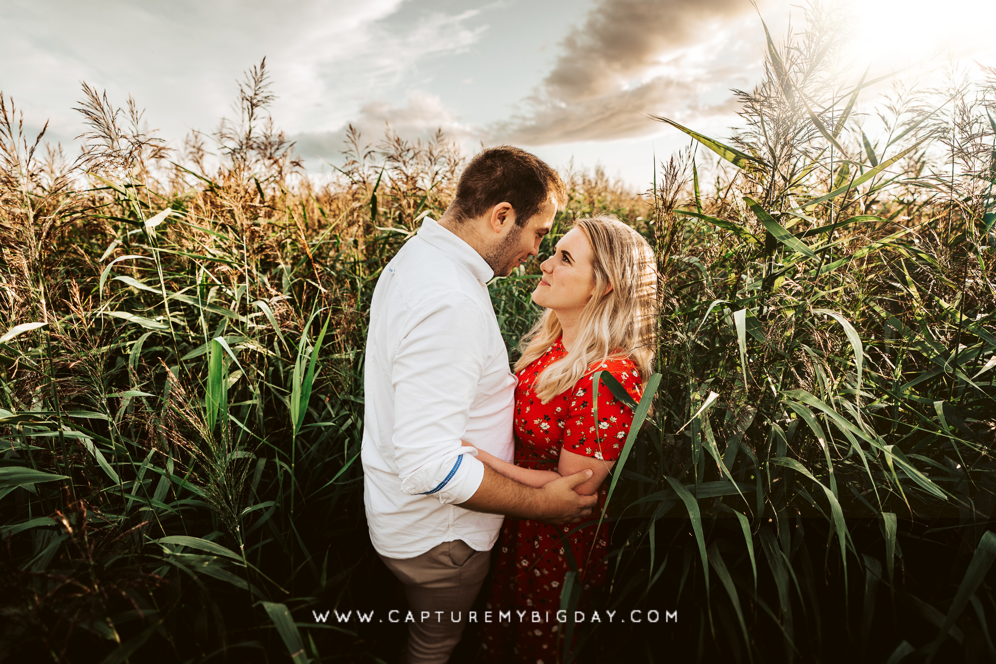 Engagement photo in the long grass