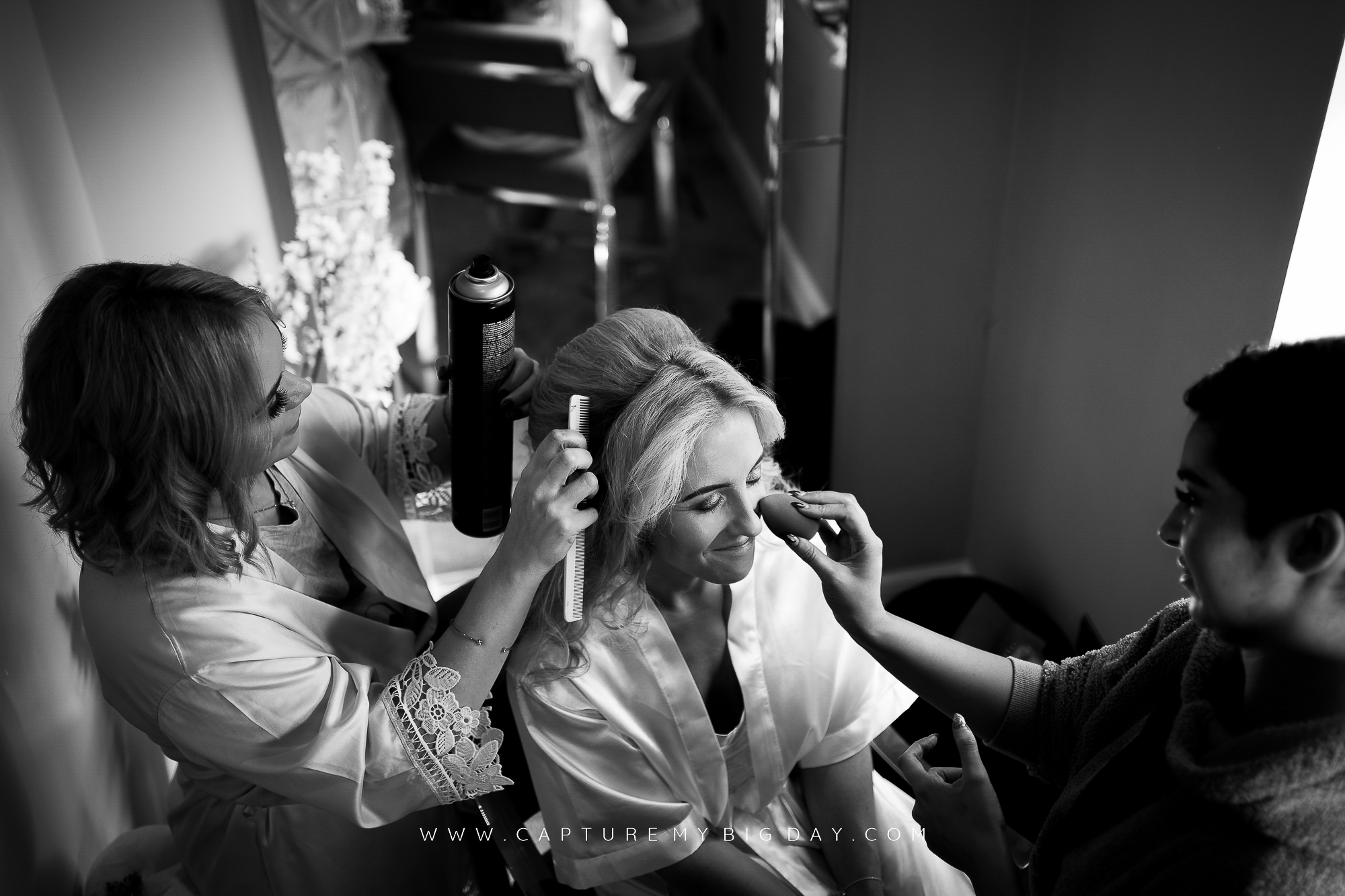Bride having her hair finished