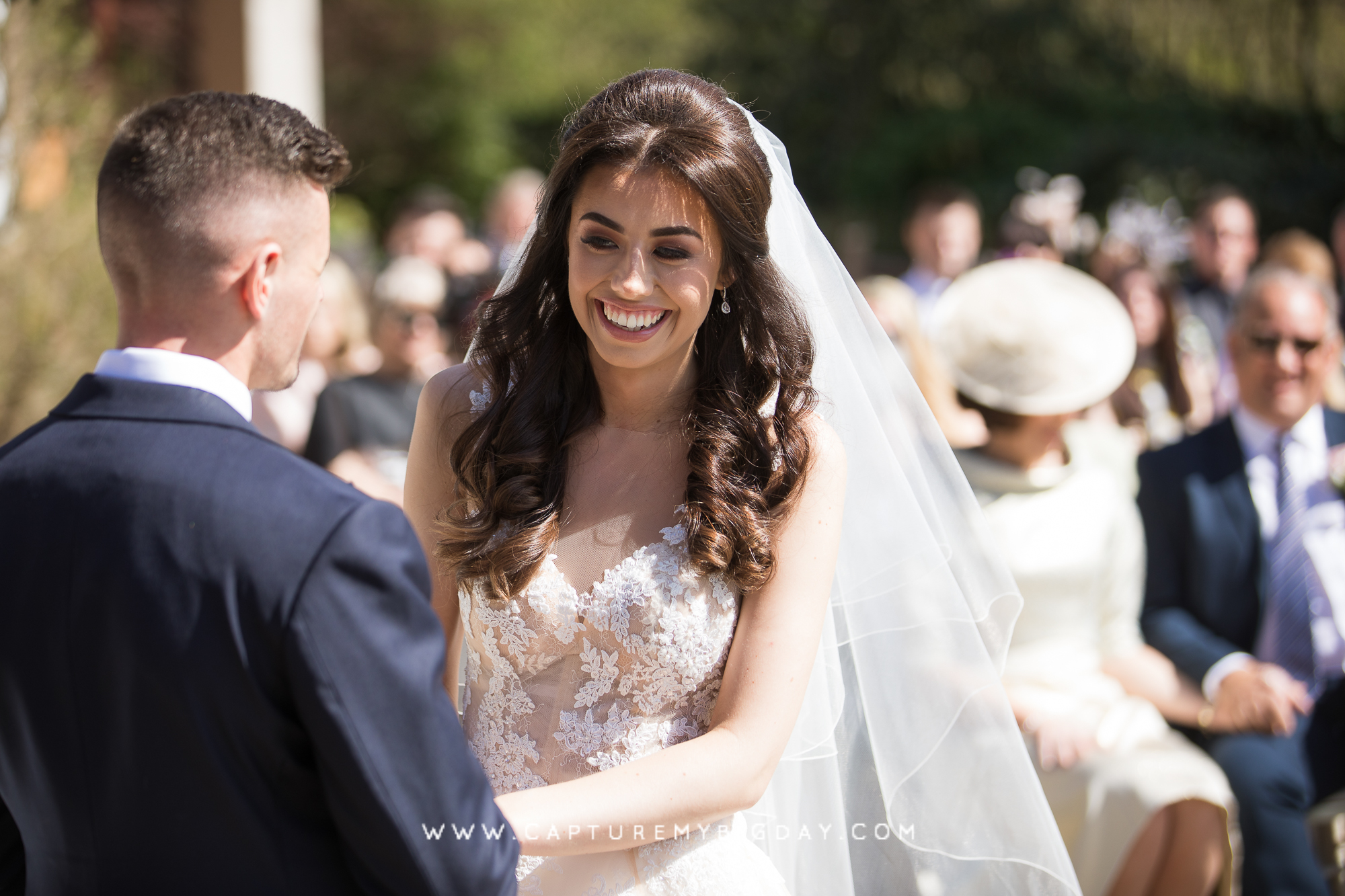 bride smiling at ceremony