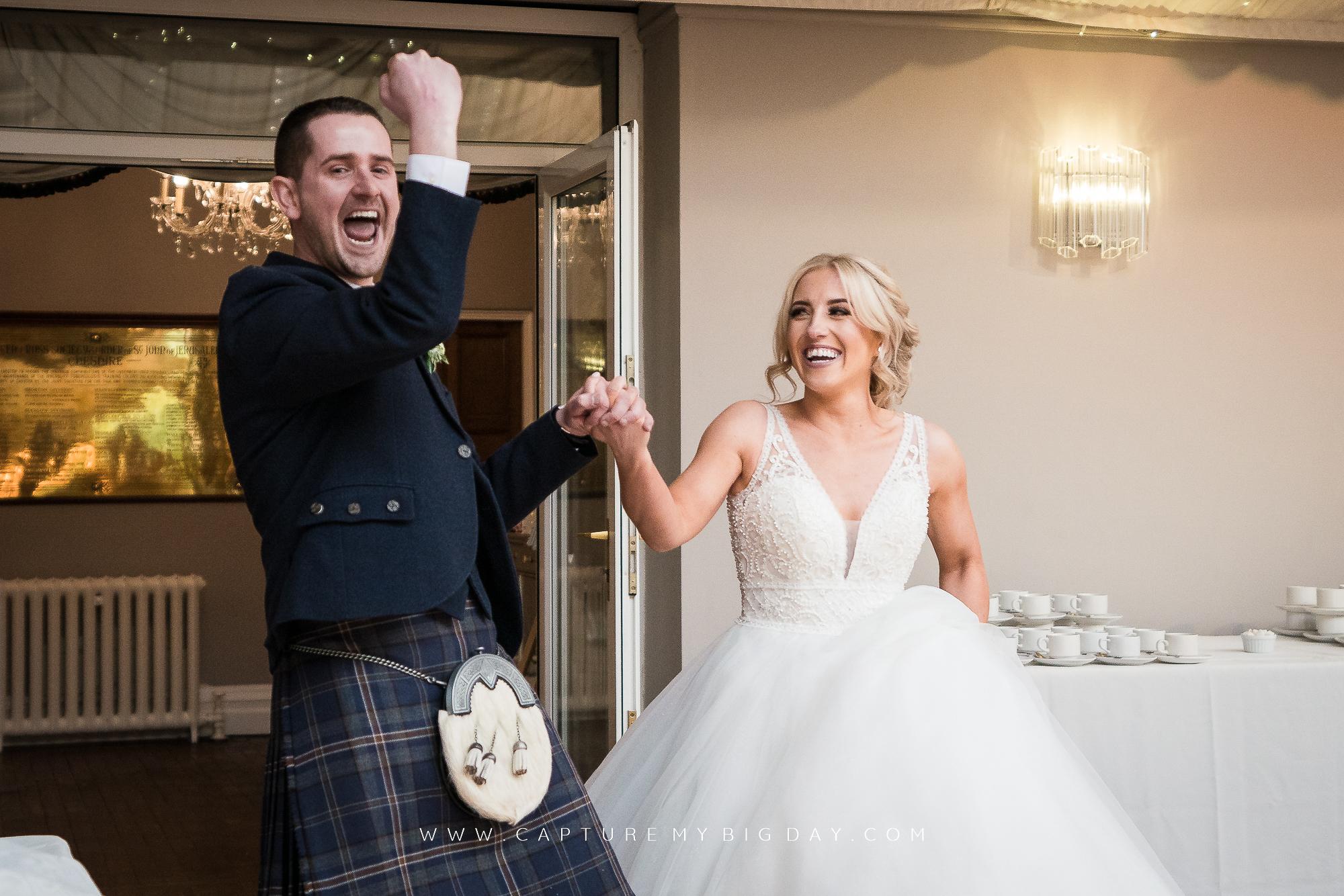 Bride and groom walking in to wedding breakfast