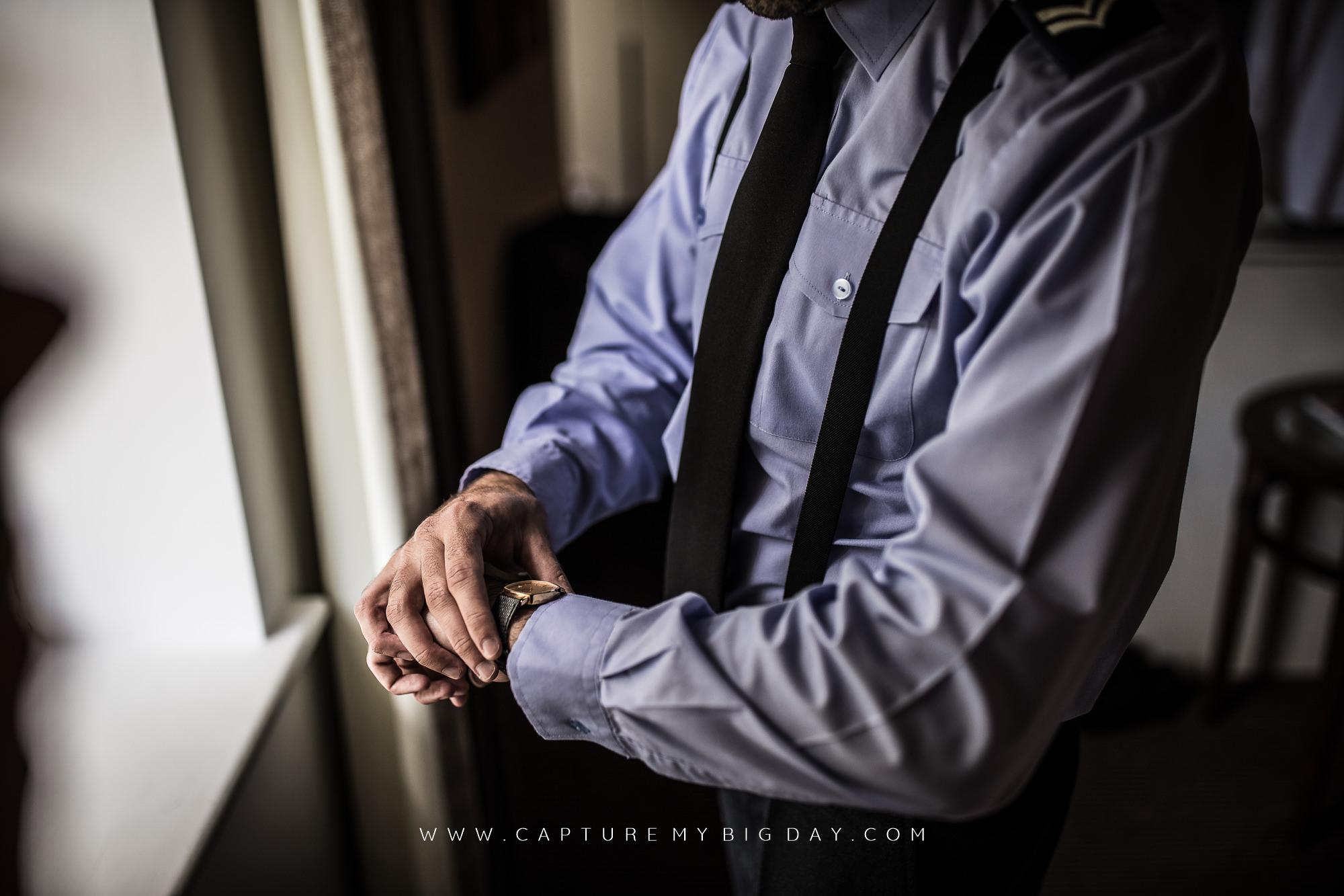 groom looking a watch