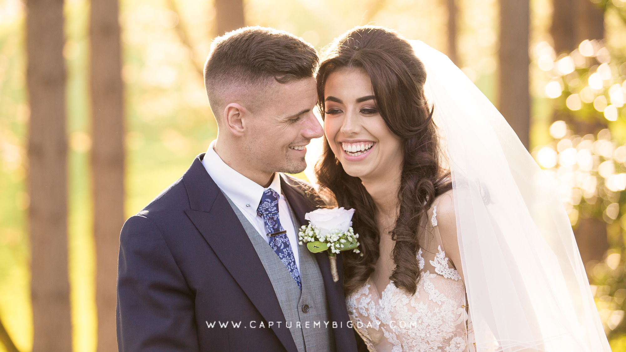 bride and groom smiling outside