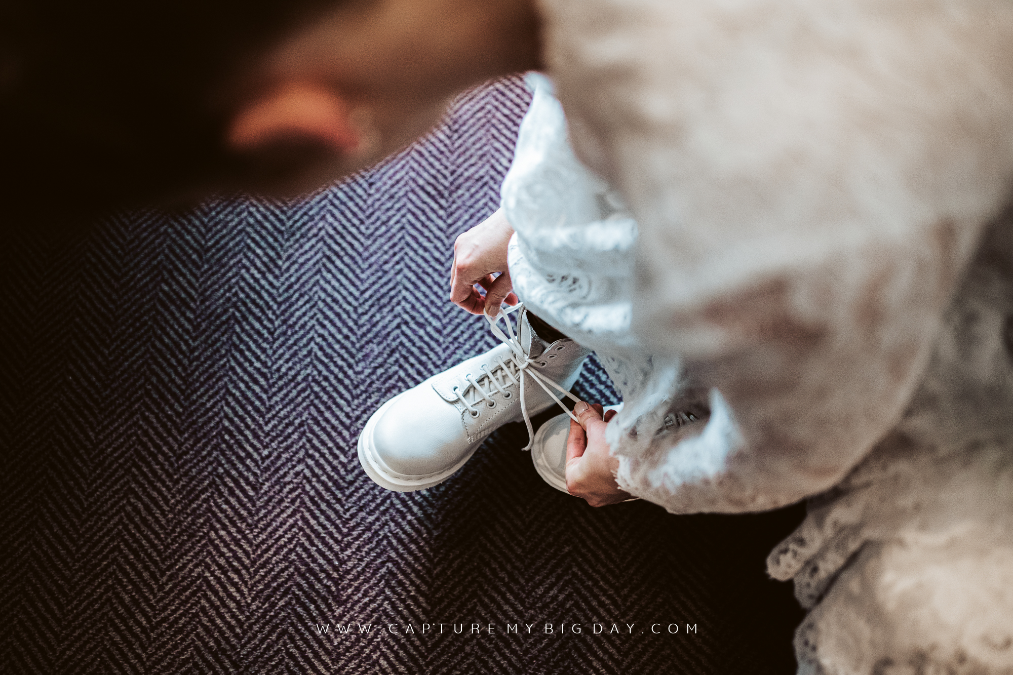 bride putting her white Doc Martins on