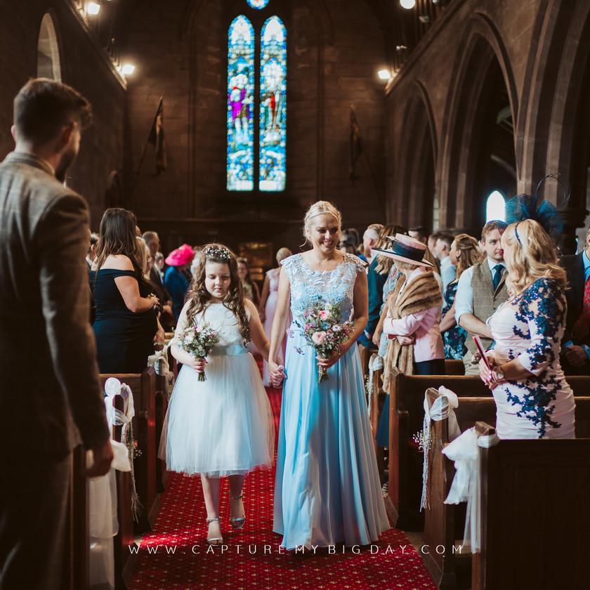 bridesmaid walking down the aisle