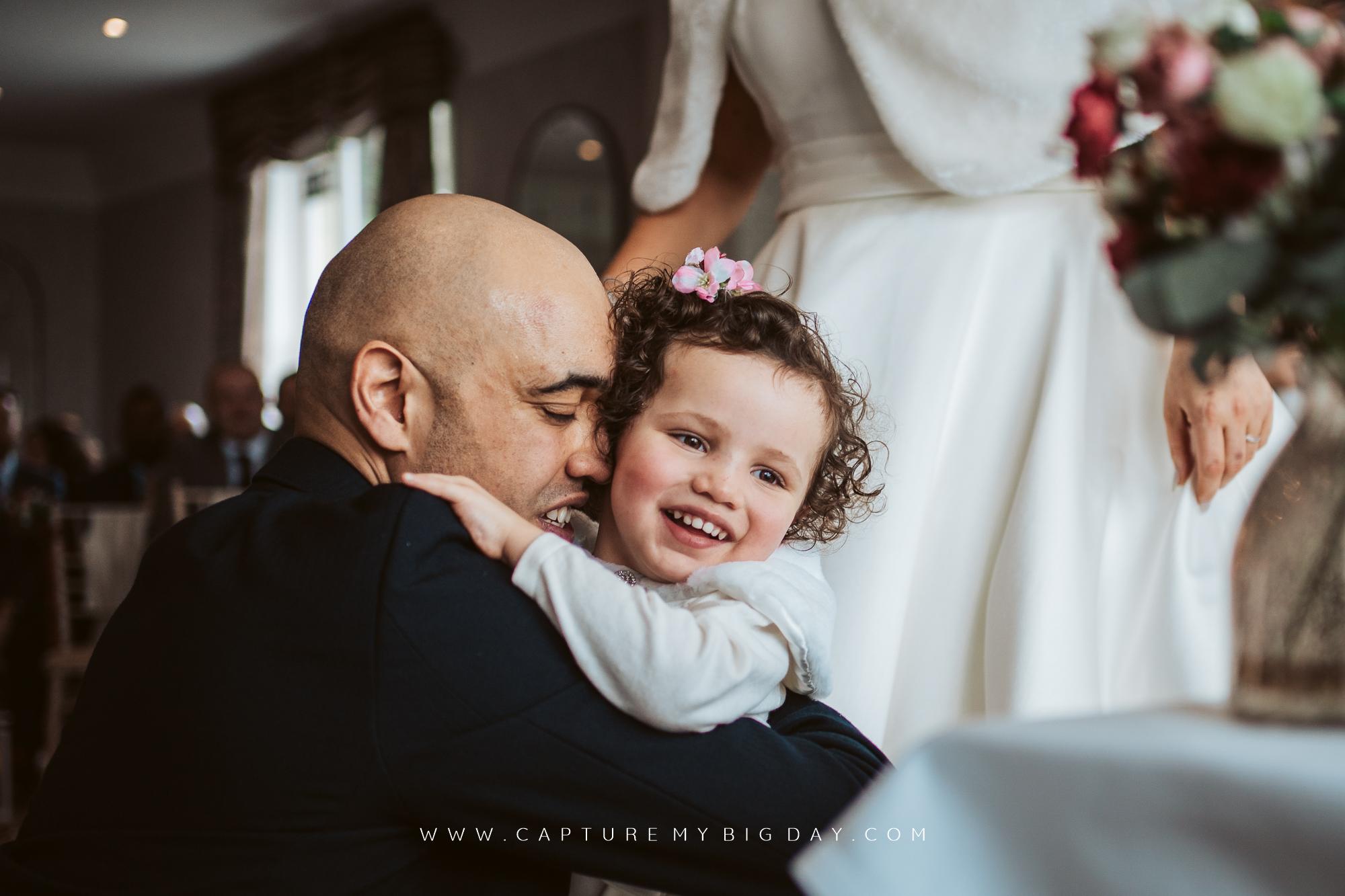 groom hugging daughter