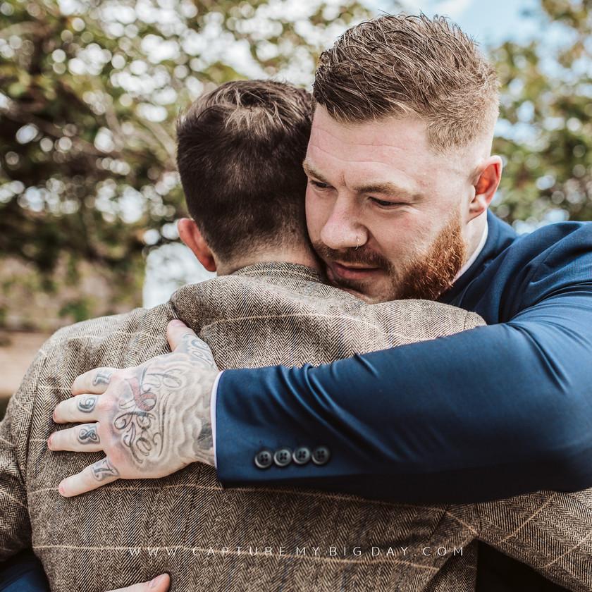 groom hugging guest