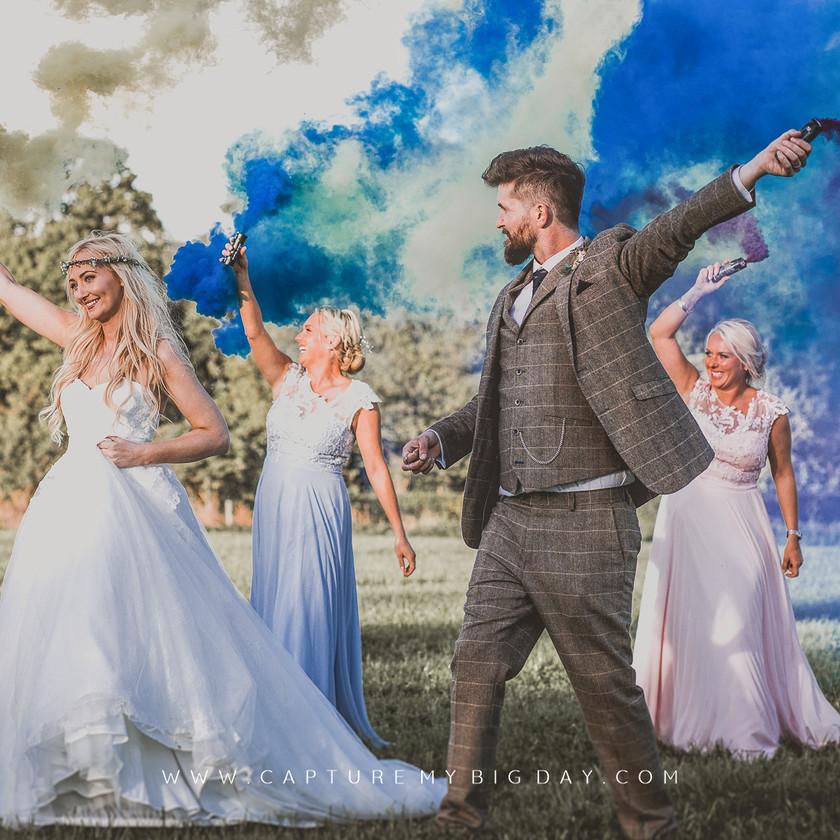 bride and groom smoke bombs