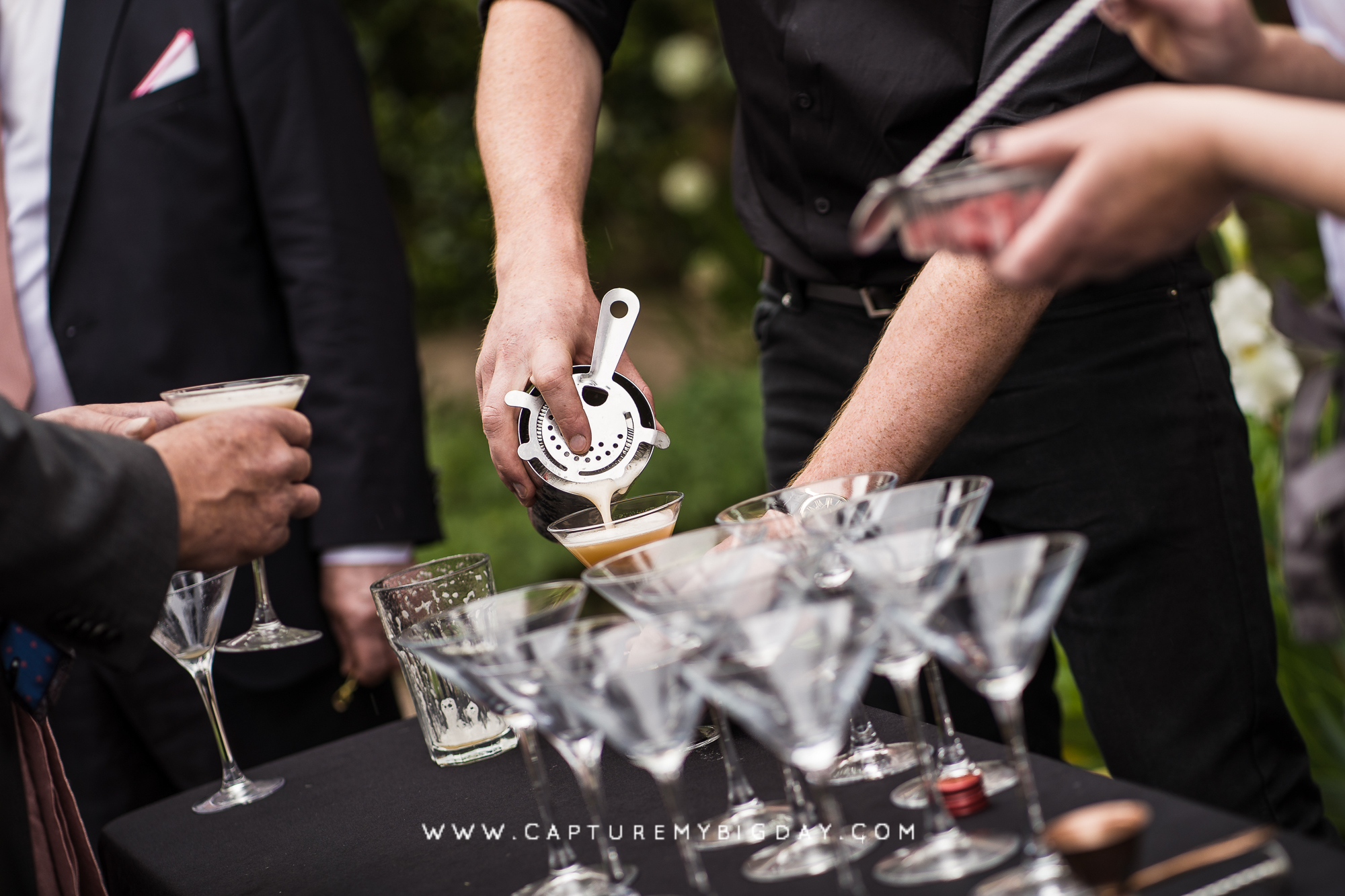 drinks being poured at wedding