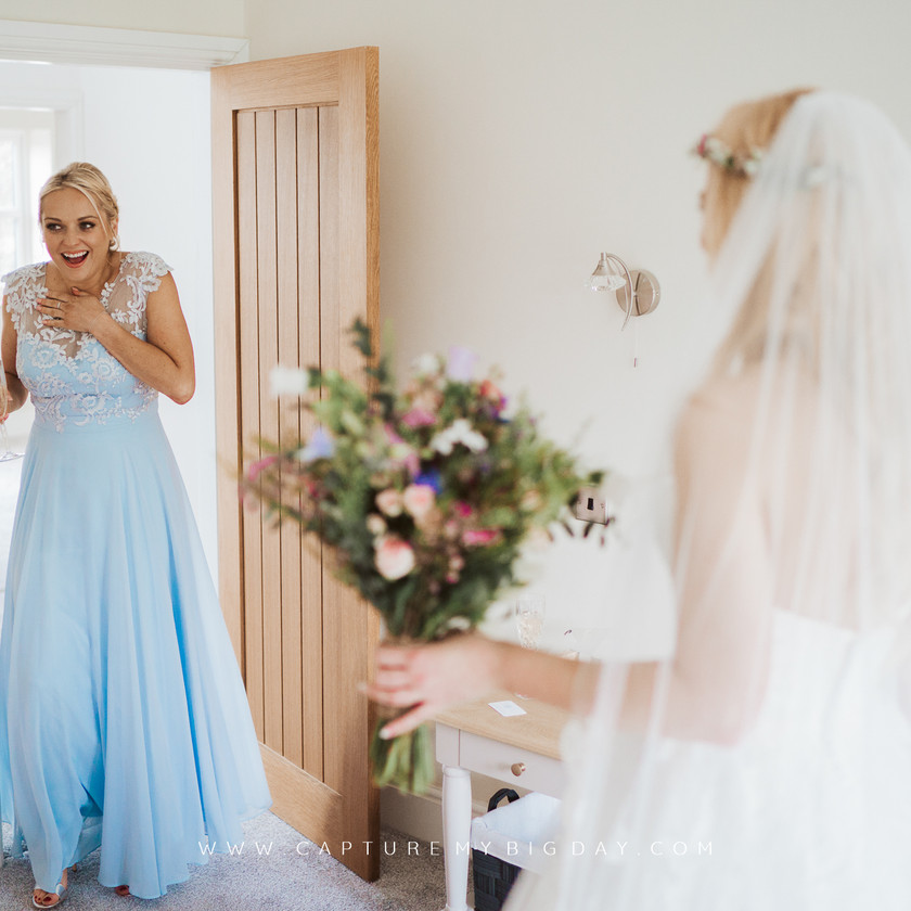 bridesmaid supervised at dress