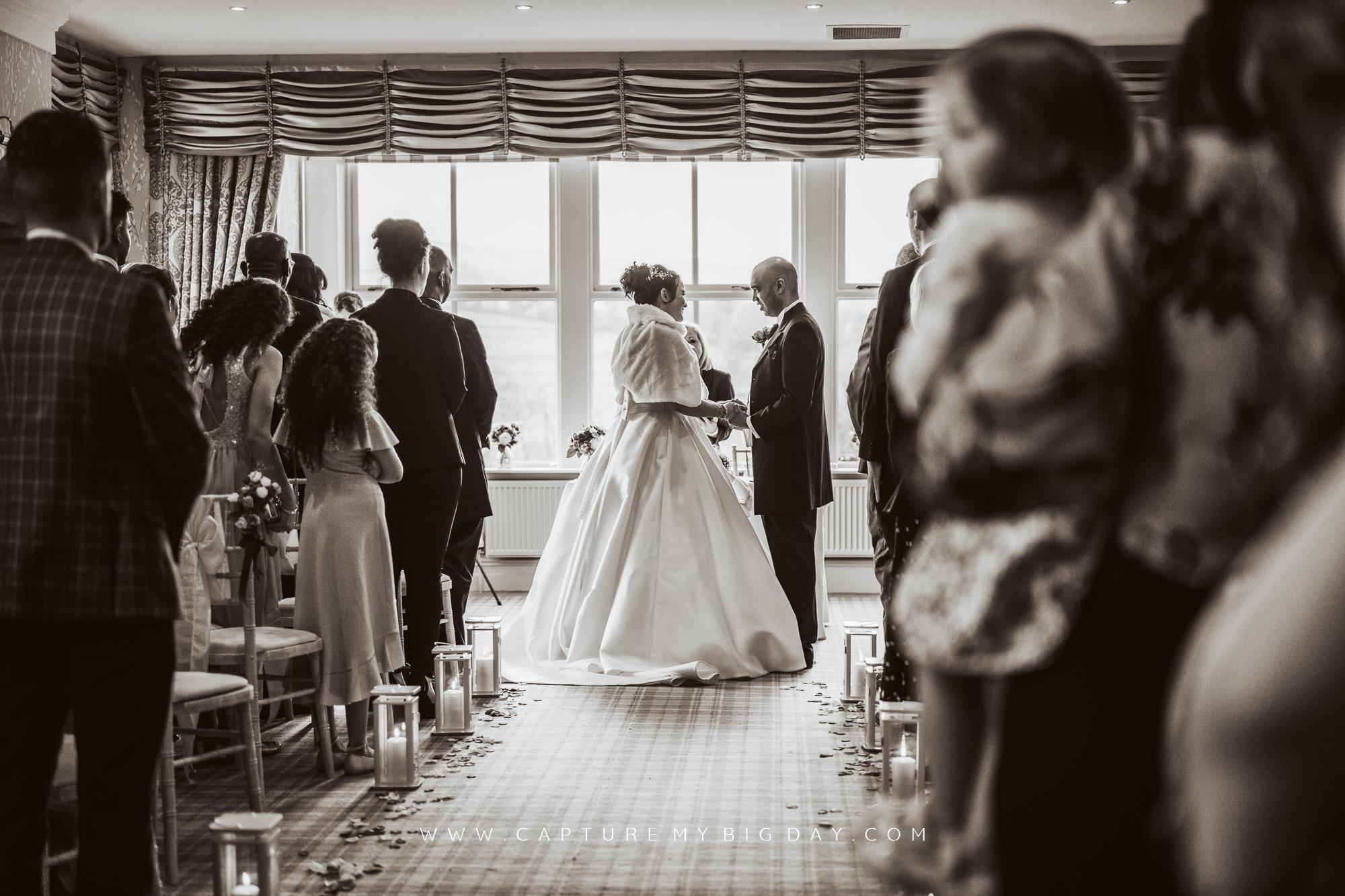 bride and groom in wedding ceremony