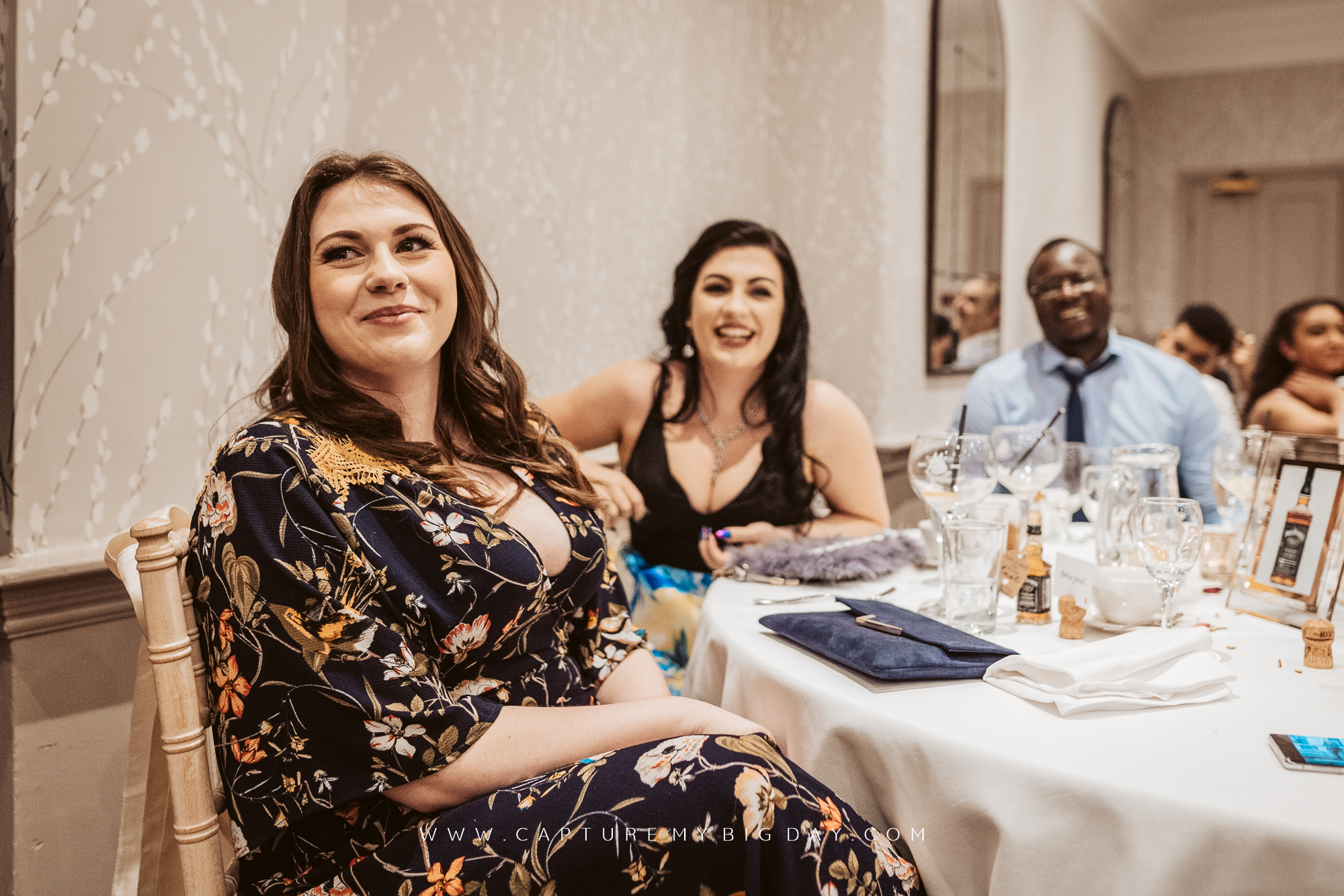 wedding guest smiling at speeches
