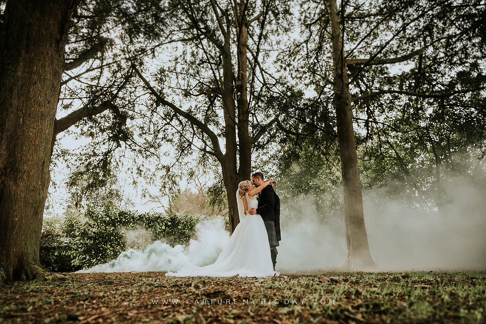 Bride and Groom photograph taken with smoke in background