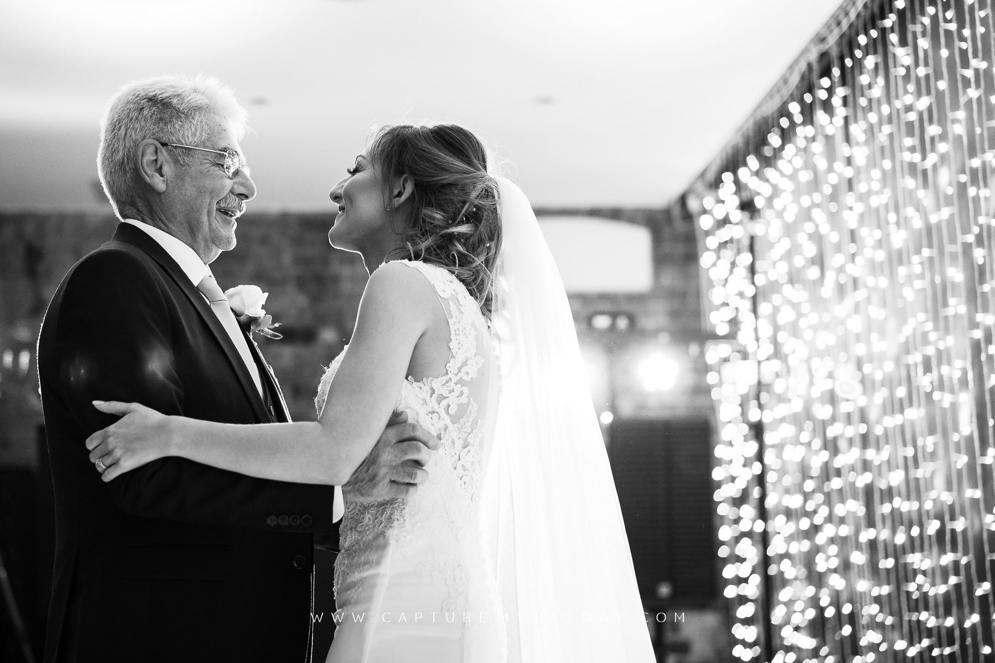 bride dancing with father