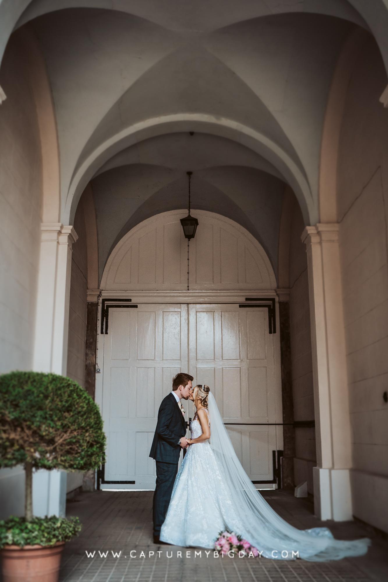 bride and groom outside doors
