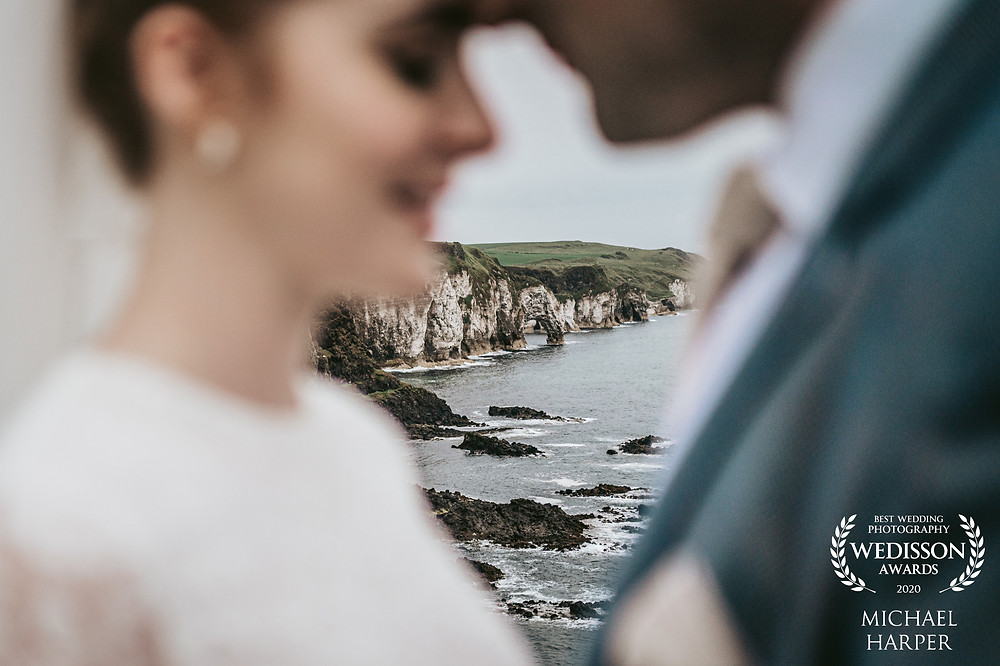 Bride and groom in Northern Ireland on cliff edge