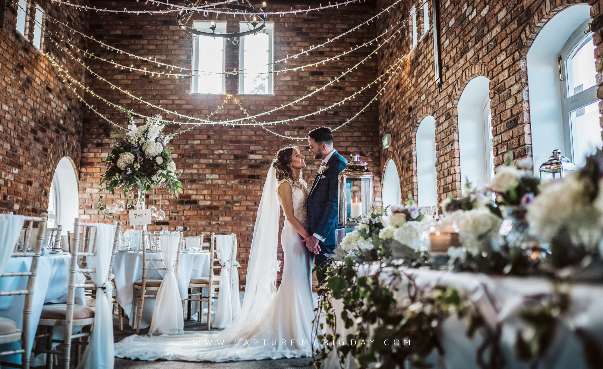 bride and groom at wedding breakfast room