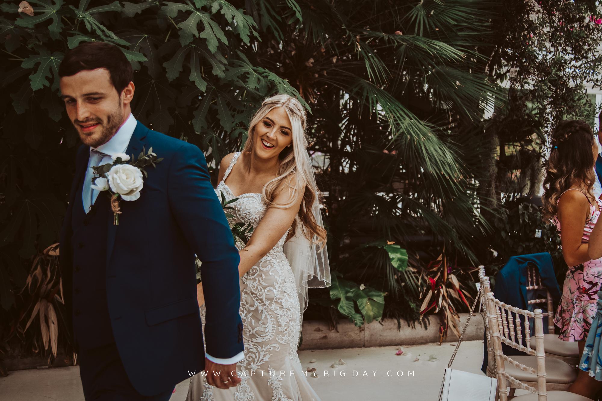 groom leading the bride into the wedding breakfast room