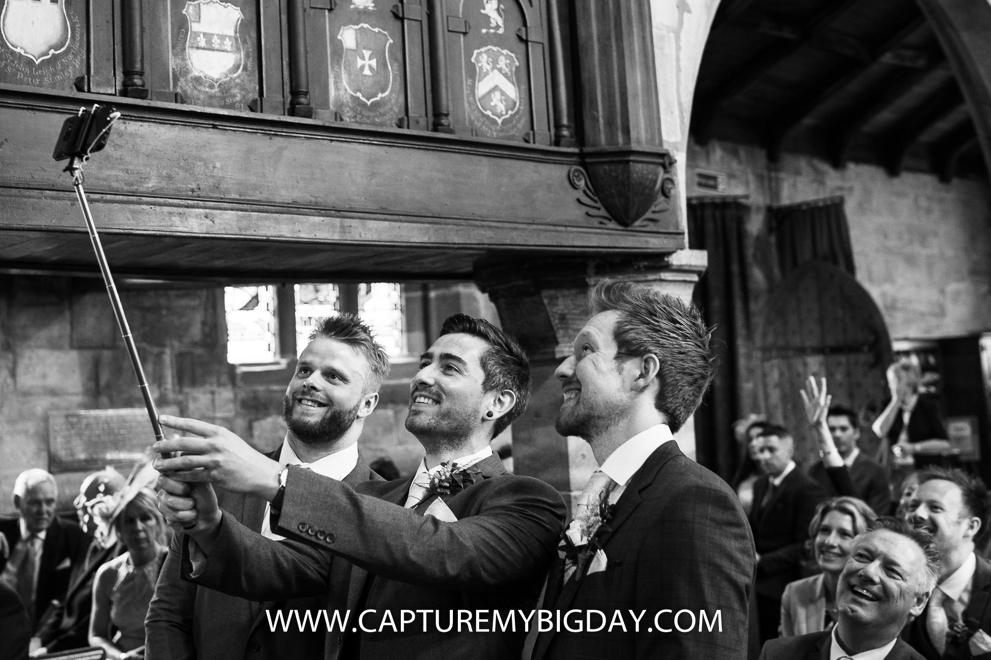 groom taking selfie in church