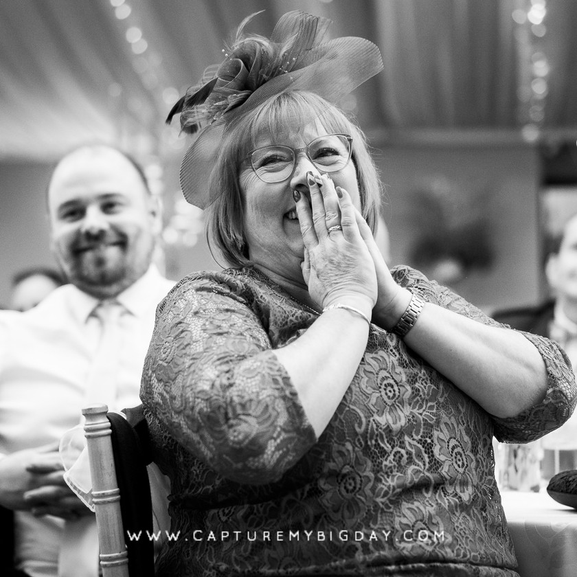 wedding guest smiling