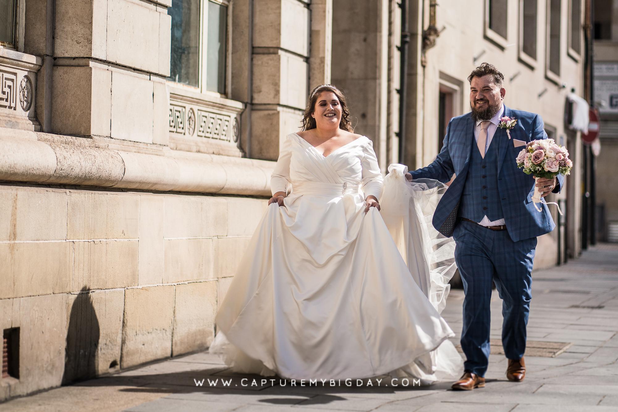 bride and groom walking outside 30 James street