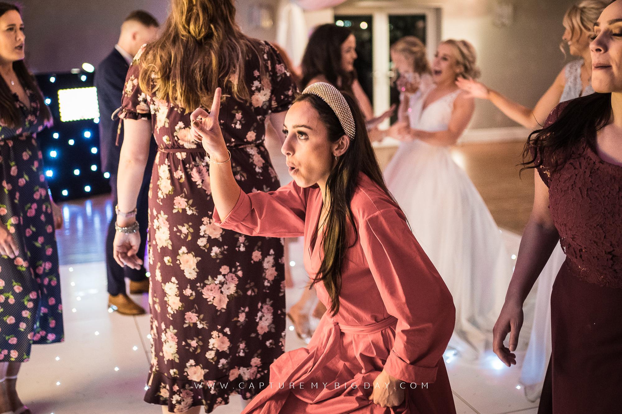 wedding guest on dancefloor