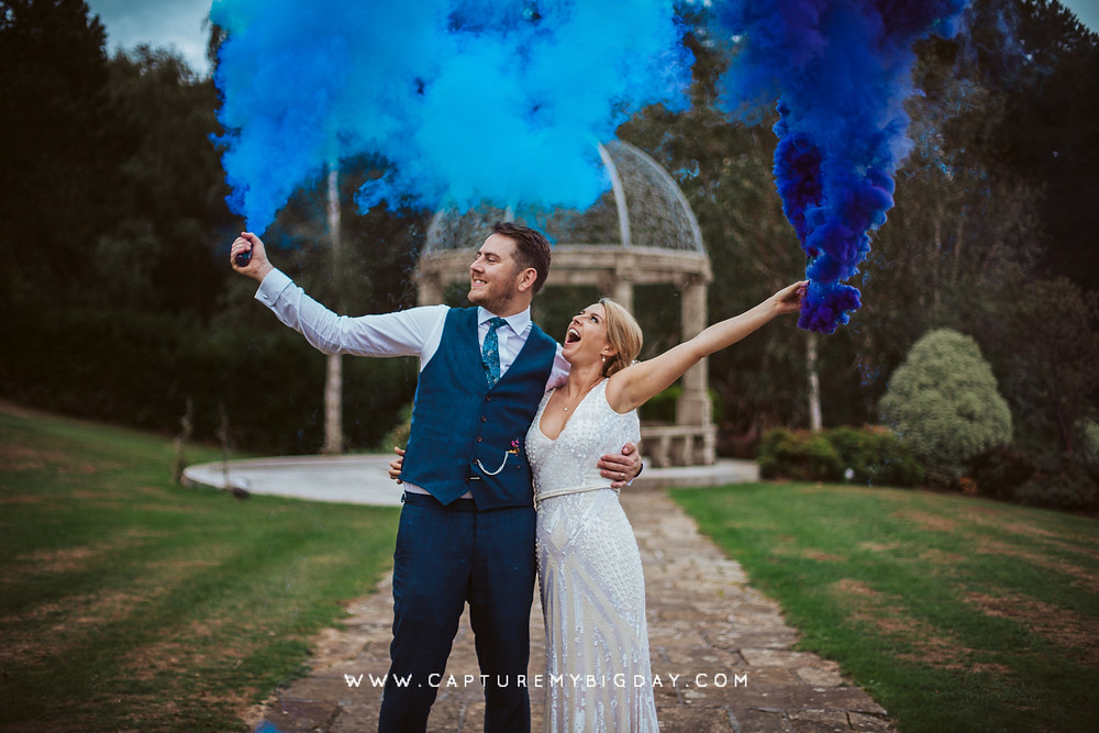 Bride and Groom with smoke bombs outside Hillbark Hotel