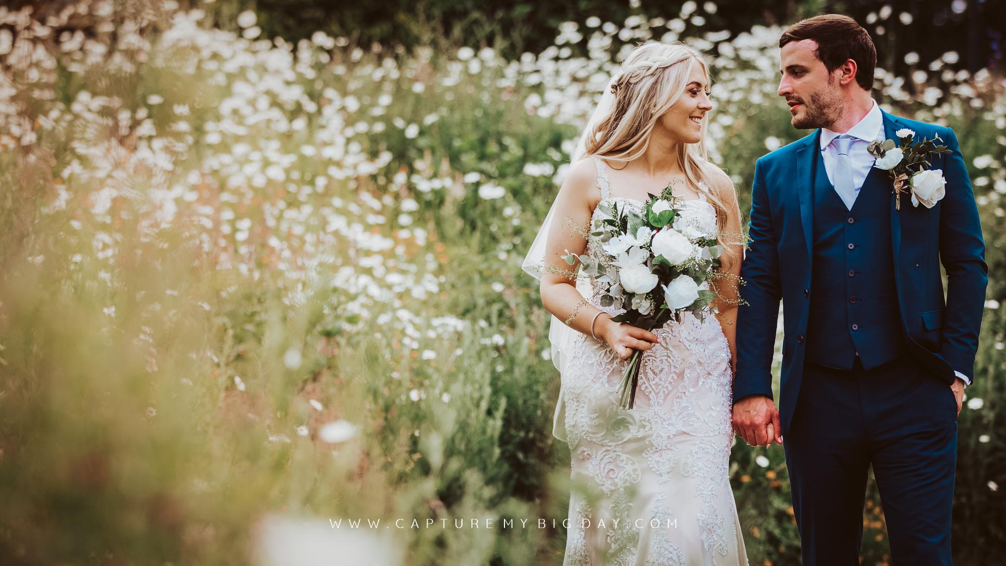 bride and groom walking in Sefton park