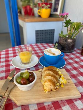 Breakfast egg croissant orange juice.JPG