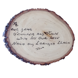 This personal piece was done using a handwritten note from the inside cover  of a book, edited in size, and burned onto live edge basswood. A unique way for the words of a loved one's to live on.