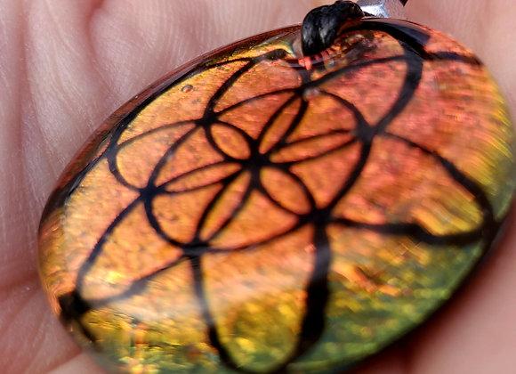 Seed of light orangy green copper dichroic glass pendant