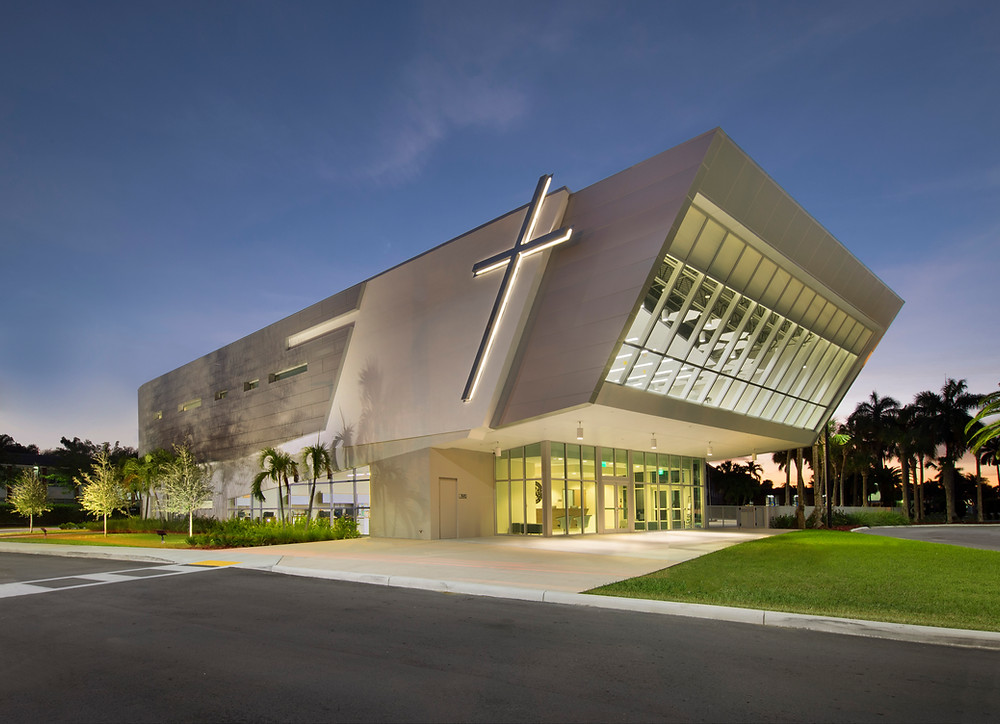 Modern building exterior with cross on side of building