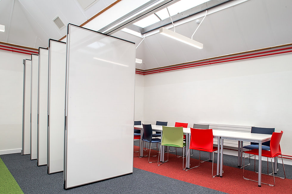 operable partition wall with magnetic and writable board finish